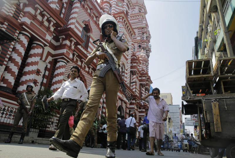 A Sri Lankan police officer patrols out side a mosque in Colombo, Sri Lanka, Wednesday, April 24, 2019. The Islamic State group has claimed responsibility for the Sri Lanka attacks on Easter Sunday and released images that purported to show the attackers. Prime Minister Ranil Wickremesinghe said that investigators were still determining the extent of the bombers' foreign links. (AP Photo/Eranga Jayawardena)