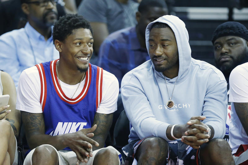 Wizards stars Bradley Beal and John Wall will not be making the trip to Orlando. (Michael Reaves/Getty Images)