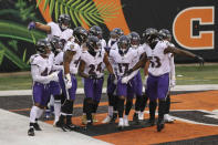 The Baltimore Ravens defense celebrates with cornerback Marcus Peters (24) after he intercepted a pass in the end zone intended for Cincinnati Bengals wide receiver A.J. Green during during the second half of an NFL football game, Sunday, Jan. 3, 2021, in Cincinnati. (AP Photo/Aaron Doster)