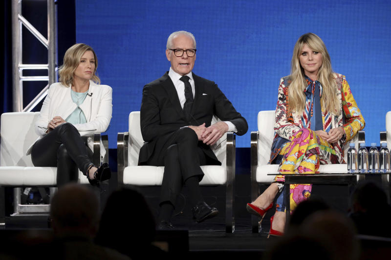 """Sara Rea, from left, Tim Gunn and Heidi Klum appear at the """"Making the Cut"""" panel during the Amazon TCA 2020 Winter Press Tour at the Langham Huntington on Tuesday, Jan. 14, 2020, in Pasadena, Calif. (Photo by Willy Sanjuan/Invision/AP)"""
