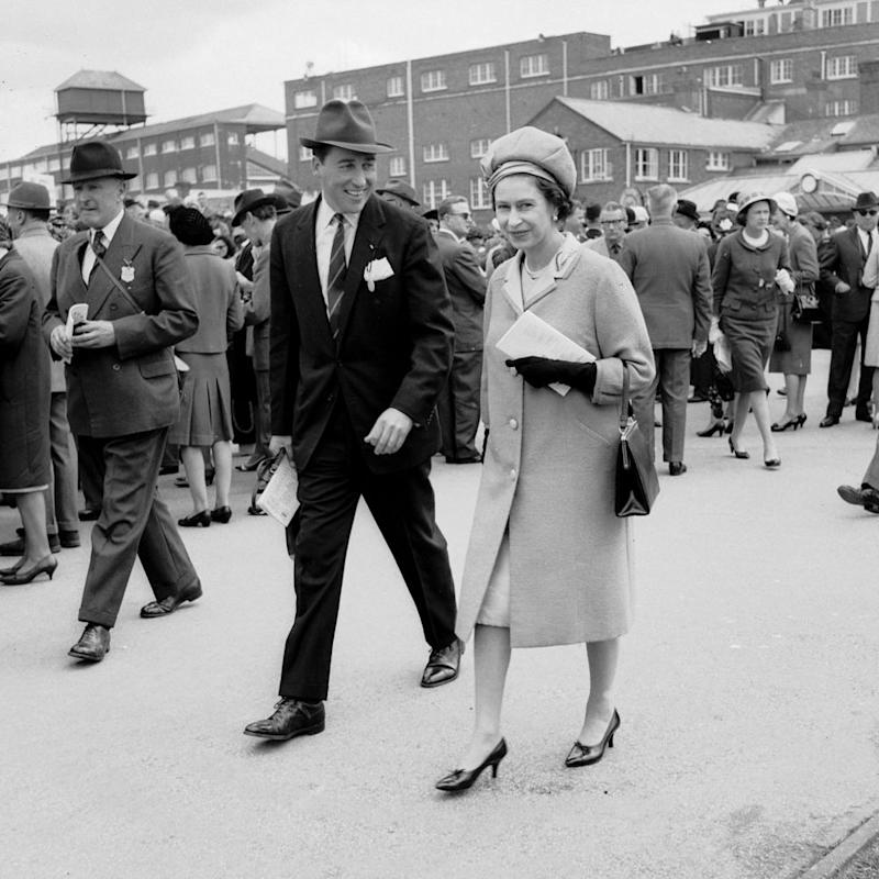 Lord Porchester and Queen Elizabeth | Roger Jackson/Central Press/Getty Images