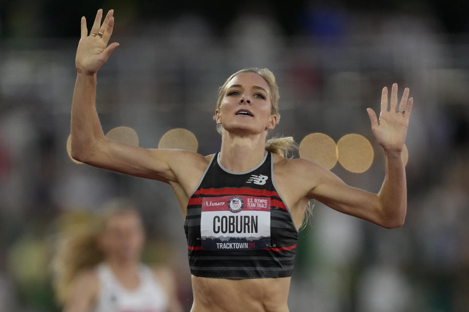 Emma Coburn celebrates after winning the women's 3000-meter steeplechase at the U.S. Olympic Track and Field Trials Thursday, June 24, 2021, in Eugene, Ore. (AP Photo/Ashley Landis)
