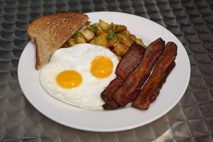 Jeannie Kim's popular bacon and eggs breakfast is seen outside her restaurant in San Francisco on Friday, July 30, 2021. Thanks to a reworked menu and long hours, Jeannie Kim managed to keep her San Francisco restaurant alive during the coronavirus pandemic. That makes it all the more frustrating that she fears her breakfast-focused diner could be ruined within months by new rules that could make one of her top menu items — bacon — hard to get in California. (AP Photo/Eric Risberg)