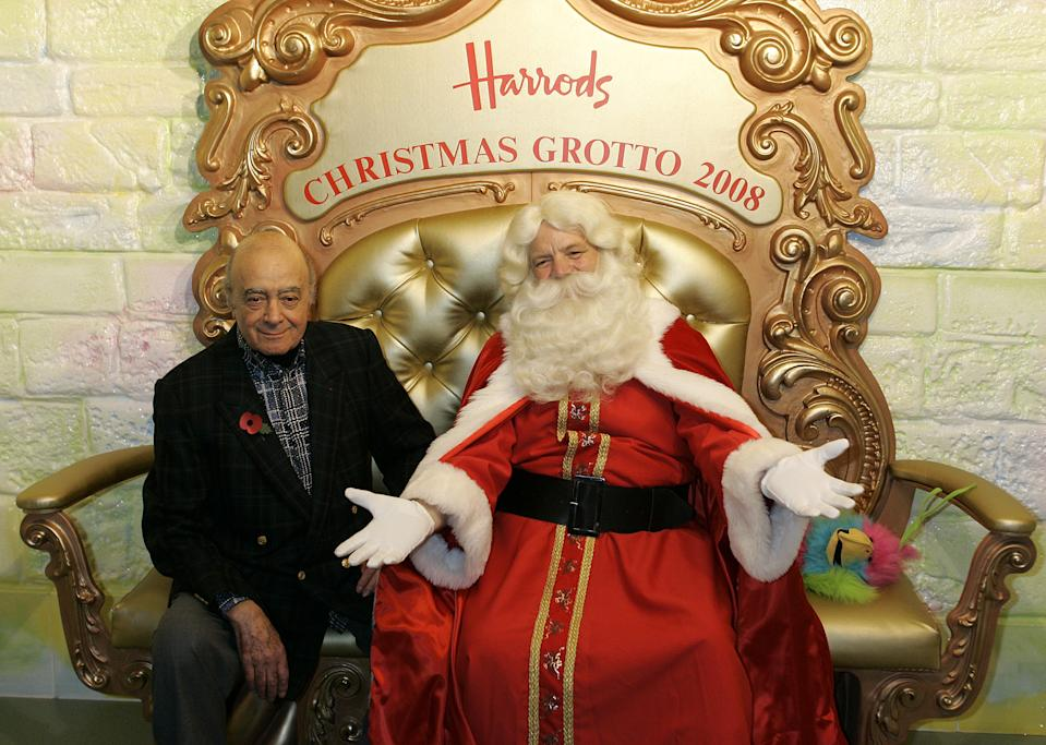 Harrods chairman Mohamed Al Fayed and a man dressed as Father Christmas pose for photographers in the Christmas grotto in the Harrods department store in London, Saturday, Nov. 1, 2008.  Saturday saw the official start to Christmas at Harrods as the annual Christmas parade brought a festive cheer to the crowd with street entertainers and performers.(AP Photo/Akira Suemori)