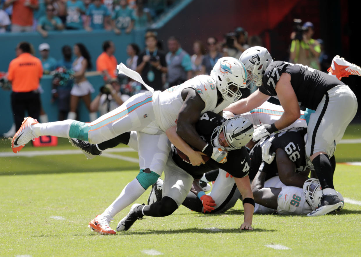 Miami Dolphins defensive end William Hayes is out for the rest of the season after tearing his right ACL on this play. (AP)