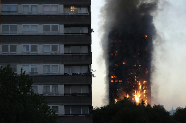 <p>Smoke and flames rise from a building on fire in London, Wednesday, June 14, 2017. Metropolitan Police in London say they're continuing to evacuate people from a massive apartment fire in west London. The fire has been burning for more than three hours and stretches from the second to the 27th floor of the building. (Matt Dunham/AP) </p>