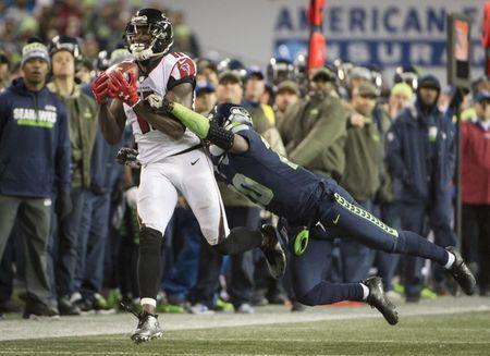 Nov 20, 2017; Seattle, WA, USA; Atlanta Falcons wide receiver Julio Jones (11) catches a pass for a first down as he is tackled by Seattle Seahawks cornerback Jeremy Lane (20) during the second half at CenturyLink Field. The Falcons won 34-31. Troy Wayrynen-USA TODAY Sports