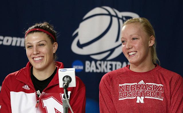 Nebraska's Jordan Hooper, left, and Emily Cady smile during a news conference on Sunday, March 23, 2014, in Los Angeles. Nebraska is scheduled to play BYU in a second-round game of the NCAA women's college basketball tournament on Monday. (AP Photo/Jae C. Hong)