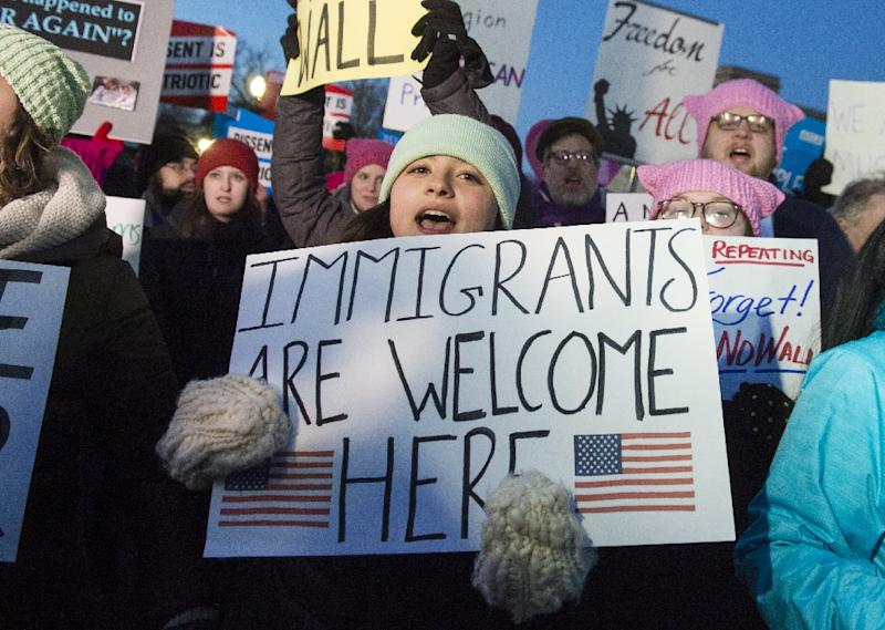 The federal order blocks Donald Trump's executive order of a 120-day ban on refugee arrivals from any country and on immigrants from Syria, Libya, Somalia, Yemen, Sudan, and Iran (AFP Photo/SAUL LOEB)