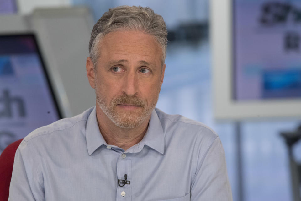 In this Wednesday, Sept. 5, 2018 photo, Jon Stewart reacts as other guests talk about the long term health effects of 9/11 on first responders during a taping of the Shepard Smith Reporting program on the Fox News Channel in New York. (AP Photo/Mary Altaffer)