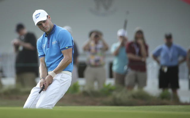 Martin Kaymer, of Germany, reacts after missing a birdie on the 13th hole during the first round of the U.S. Open golf tournament in Pinehurst, N.C., Thursday, June 12, 2014. (AP Photo/Charlie Riedel)