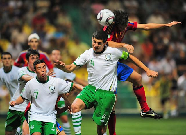 Ignasi Miguel (R) of Spain vies for the ball with John Egan (C) of Ireland during their UEFA European Under-19 Championship football match, near the village of Chiajna village, outside of Bucharest, on July 29, 2011. AFP PHOTO/DANIEL MIHAILESCU (Photo credit should read DANIEL MIHAILESCU/AFP/Getty Images)