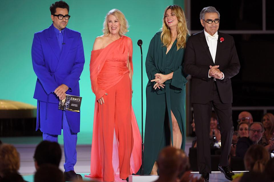 Dan Levy, from left, Catherine O'Hara, Annie Murphy, and Eugene Levy present the award for outstanding writing for a comedy series.