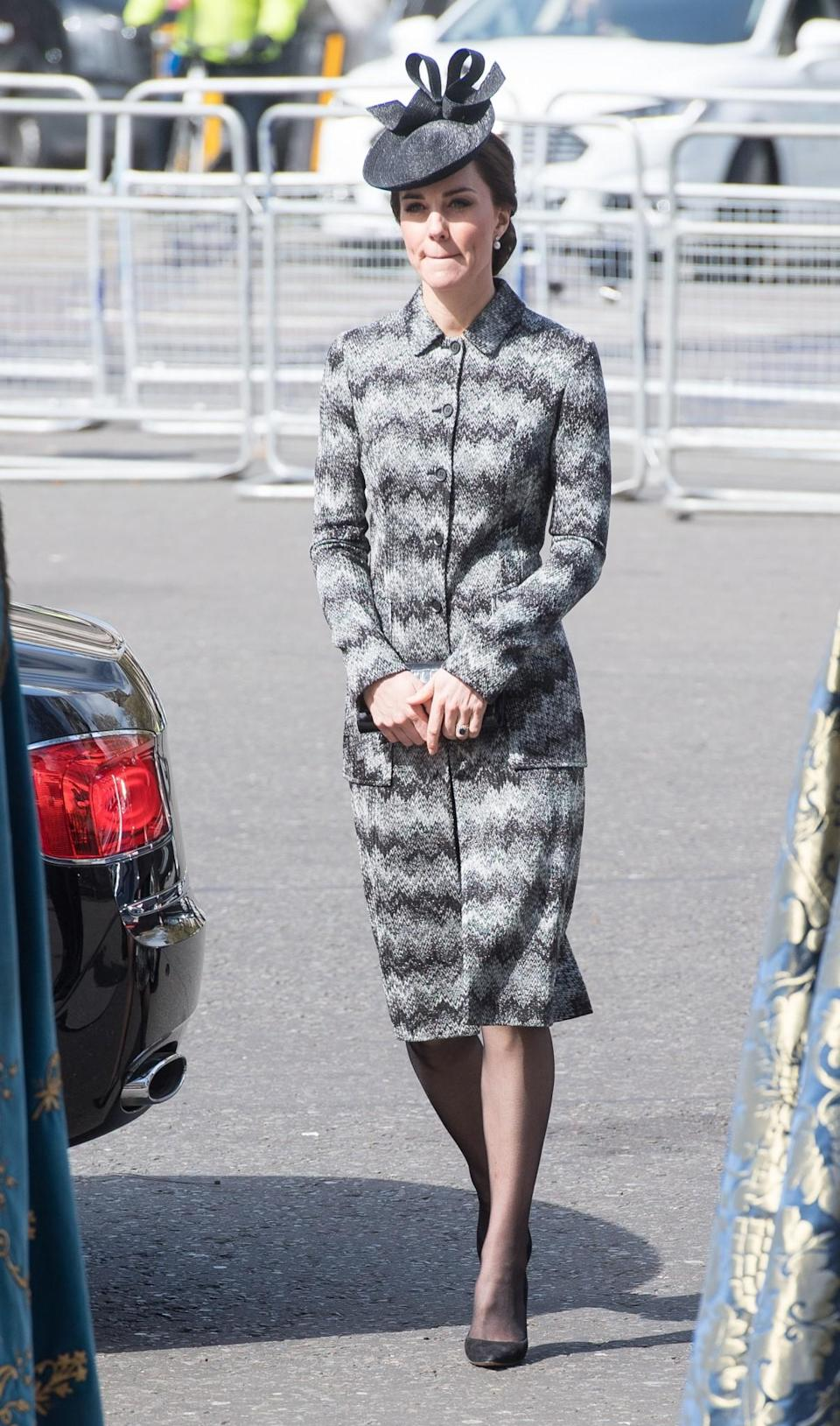 <p>The Duchess chose a suitably sombre look for a memorial service remembering the victims of the Westminster attack. She wore a zig-zag printed coat by Missoni (costing £2900) with a bow-topped black hat. A black clutch and heeled pumps added to the dark ensemble.<br><i>[Photo: PA]</i> </p>