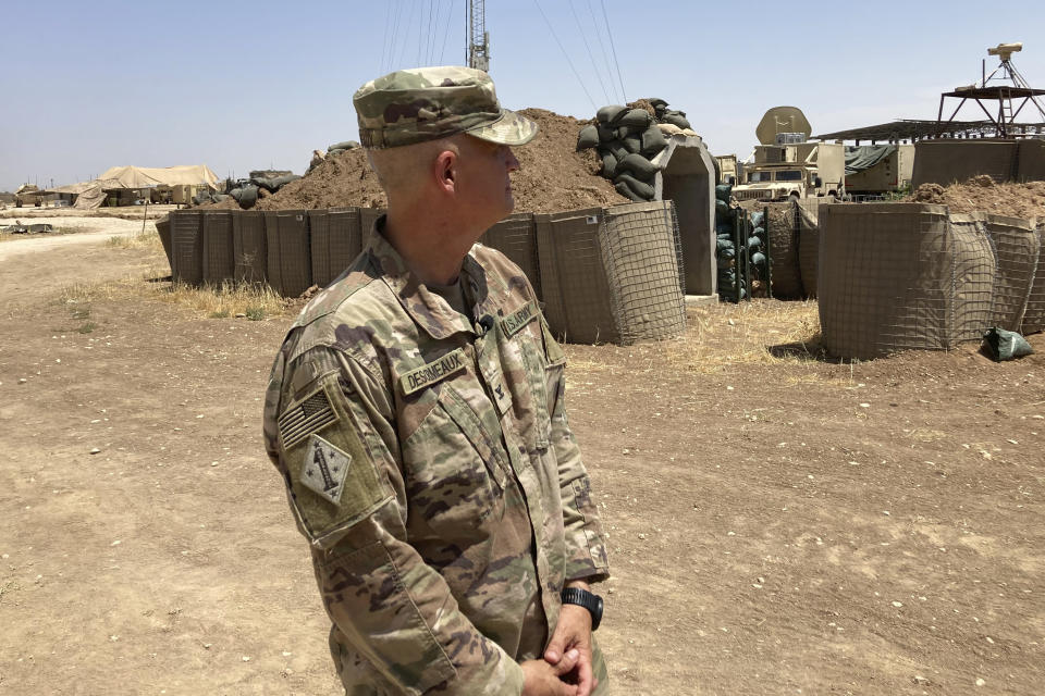 In this May 21, 2021, photo Col. Scott Desormeaux, who is with the Louisiana National Guard, talks to reporters in northern Syria during a visit by Marine Gen. Frank McKenzie, top U.S. commander for the Middle East. The Syria deployment is just one of many missions the Louisiana Guard had to juggle over the past year. (AP Photo/Lolita Baldor)