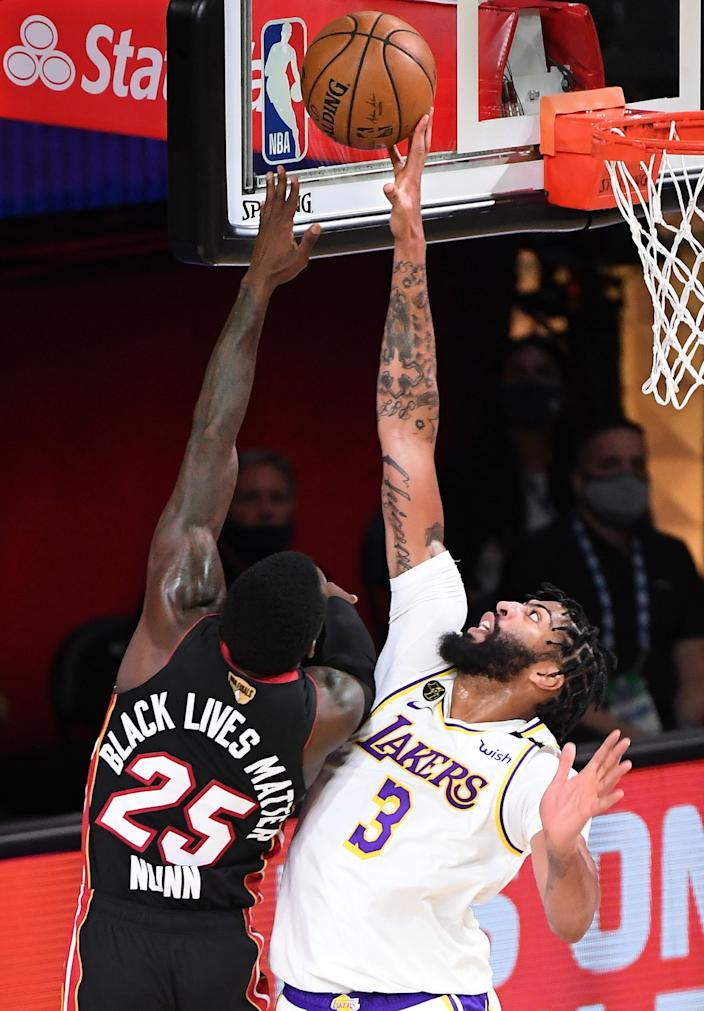 Lakers' Anthony Davis blocks a shot by the Heat's Kendrick Nunn during the second quarter in Game 6 on Sunday in Orlando.