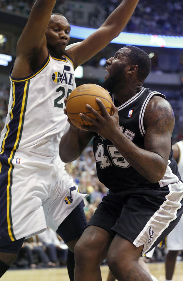 San Antonio Spurs forward DeJuan Blair (45) looks for a shot against Utah Jazz center Al Jefferson (25) during the first half of an NBA basketball game Monday, April 9, 2012, in Salt Lake City. (AP Photo/Jim Urquhart)