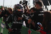 Mercedes' British driver Lewis Hamilton celebrates in the parc ferme with his team after taking the pole position after the qualifying session at the Autodromo Internacional do Algarve on October 24, 2020 in Portimao ahead of the Portuguese Formula One Grand Prix. (Photo by JOSE SENA GOULAO / POOL / AFP) (Photo by JOSE SENA GOULAO/POOL/AFP via Getty Images)