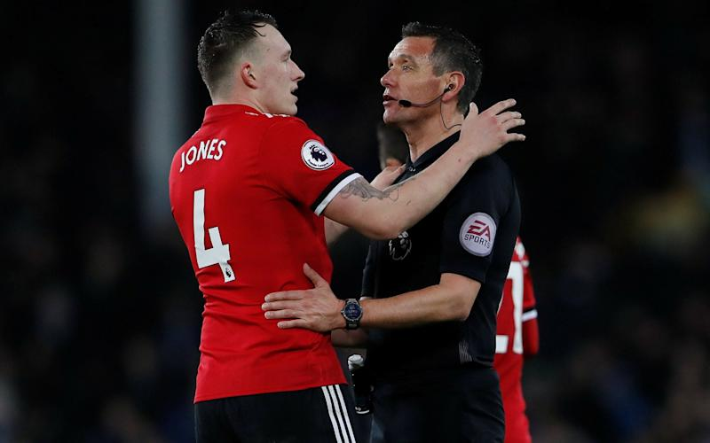 Andre Marriner (R) was one of many referees who was given a hugely demanding festive schedule - Action Images via Reuters