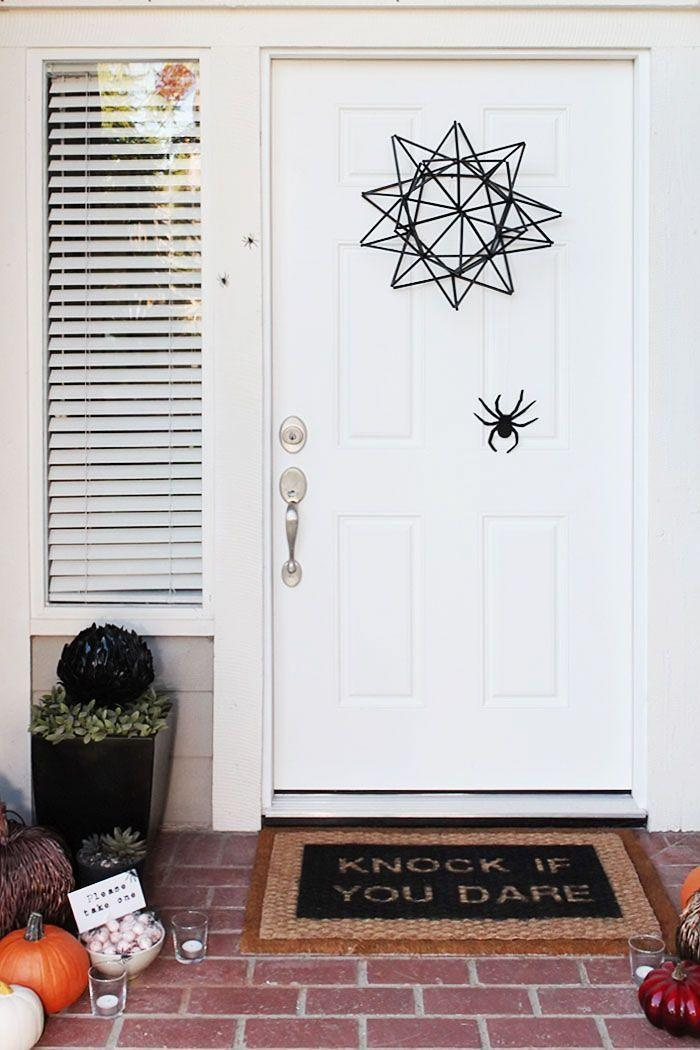 """<p>Keep things simple and stylish with a geometric star wreath, a cute door mat, and an oversized black spider. It's just spooky enough!</p><p><strong>Get the tutorial at <a href=""""https://ahomefordesign.com/Blogpost/uopt/Halloween-straw-spider-web-door-wreath"""" rel=""""nofollow noopener"""" target=""""_blank"""" data-ylk=""""slk:A Home for Design"""" class=""""link rapid-noclick-resp"""">A Home for Design</a>.</strong></p><p><a class=""""link rapid-noclick-resp"""" href=""""https://go.redirectingat.com?id=74968X1596630&url=https%3A%2F%2Fwww.walmart.com%2Fsearch%2F%3Fquery%3Dblack%2Bstraws&sref=https%3A%2F%2Fwww.thepioneerwoman.com%2Fholidays-celebrations%2Fg32894423%2Foutdoor-halloween-decorations%2F"""" rel=""""nofollow noopener"""" target=""""_blank"""" data-ylk=""""slk:SHOP BLACK STRAWS"""">SHOP BLACK STRAWS</a></p>"""