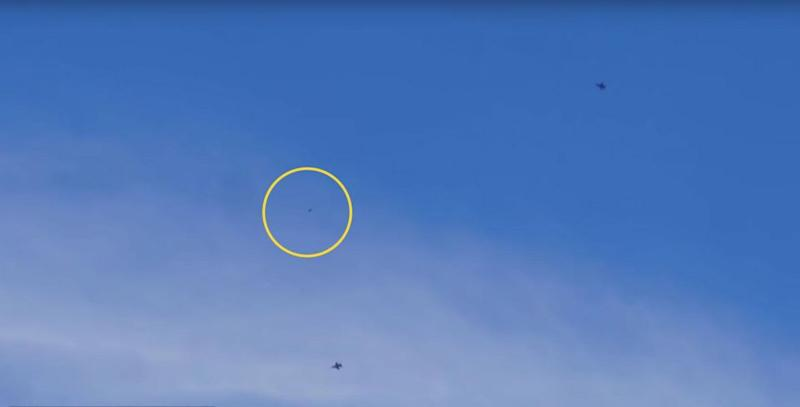 Alien seekers captured the image of two jet fighters - and one mystery flying object - in Nevada. Photo: Youtube/thirdphaseofmoon