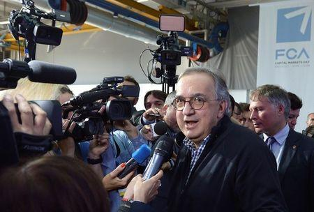 Fiat Chrysler Automobiles CEO Sergio Marchionne leaves at the end of news conference in Balocco