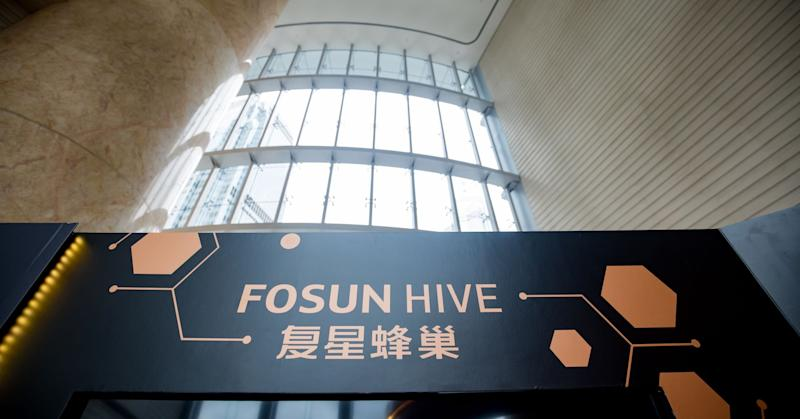 Signage for Fosun Hive is displayed in an exhibition area at a Fosun International Ltd. news conference in Hong Kong, China, on Wednesday, Aug. 29, 2018.