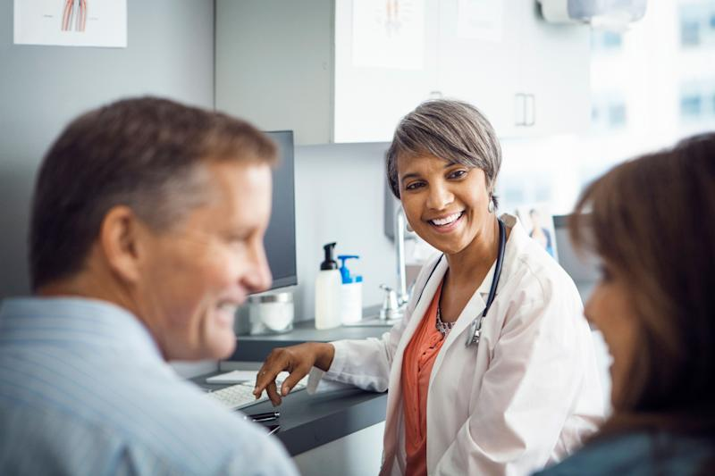 Offering to find a doctor or dentist for your partner, and setting up an appointment for them, can get the ball rolling. (Photo: Cavan Images via Getty Images)