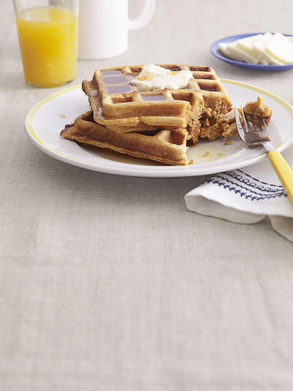 """<p>Linda Owens Surfus, the <em>Country Living </em>reader who created this recipe, recommends grating orange into the batter for extra zest.</p><p><strong><a href=""""https://www.countryliving.com/food-drinks/recipes/a3716/sweet-potato-waffles-recipe-clx1111/"""" rel=""""nofollow noopener"""" target=""""_blank"""" data-ylk=""""slk:Get the recipe"""" class=""""link rapid-noclick-resp"""">Get the recipe</a>.</strong></p>"""