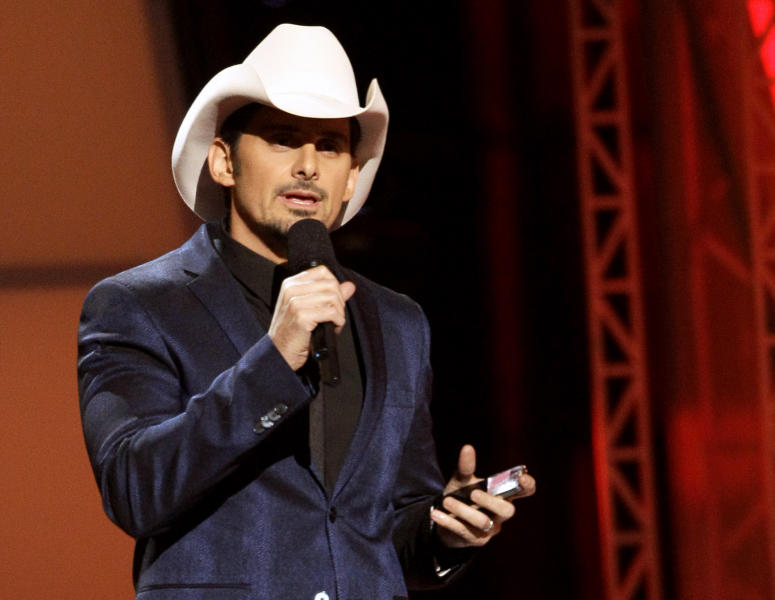 "FILE - This Nov. 1, 2012 file photo shows Brad Paisley hosting the 46th Annual Country Music Awards at the Bridgestone Arena in Nashville, Tenn. Paisley's collaboration with LL Cool J on ""Accidental Racist"" has accidentally kicked up some controversy. The song about racial perception has drawn ire from both the country and urban music worlds after its wide release. (Photo by Wade Payne/Invision/AP, file)"