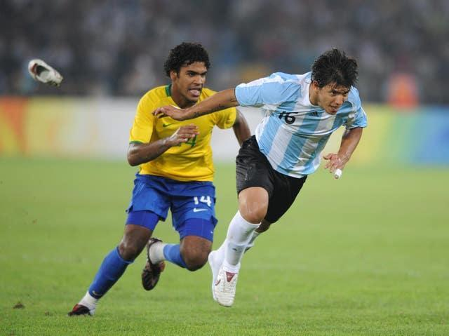 Sergio Aguero, right, won an Olympic gold medal with Argentina in 2008