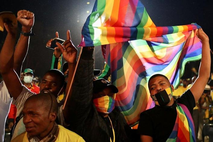 Supporters of the African National Congress (ANC) sing as they hold the LGBTQ flag during the launch of an election manifesto at the church square in Pretoria, South Africa, September 27, 2021.