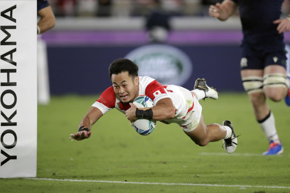 FILE - In this Oct. 13, 2019, file photo, Japan's Kenki Fukuoka scores a try during the Rugby World Cup Pool A game at International Stadium against Scotland in Yokohama, Japan. Fukuoka will retire after playing for the Panasonic Wild Knights against Suntory Sungoliath in the final of Japan's Top League club competition on Sunday May 23. (AP Photo/Jae Hong, File)