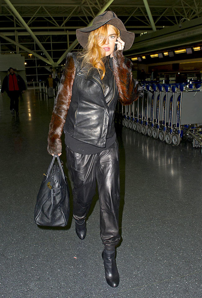 Lindsay Lohan arriving at JFK airport in New York City. Pictured: Lindsay Lohan Ref: SPL488086 290113 Picture by: Splash News Splash News and Pictures Los Angeles: 310-821-2666 New York: 212-619-2666 London: 870-934-2666 photodesk@splashnews.com