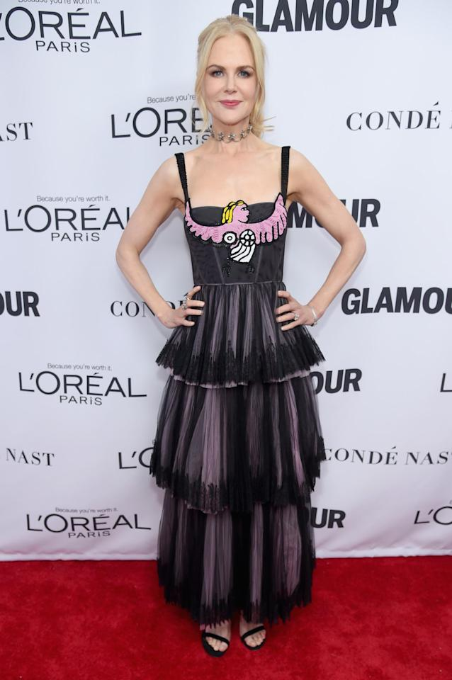<p>Nicole wore a sheer black dress with a bird embroidered on the bodice.</p>