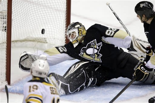 Pittsburgh Penguins goalie Tomas Vokoun (92) can't stop a shot by Boston Bruins center Tyler Seguin (19) for a goal in the first period of an NHL hockey game in Pittsburgh Sunday, March 17, 2013. (AP Photo/Gene J. Puskar)