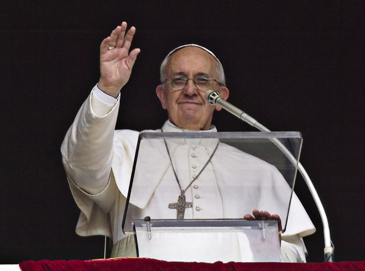 Pope Francis waves to the crowd after the Regina Coeli prayer from the window of his studio overlooking St. Peter's Square at the Vatican, Monday, April 1, 2013. (AP Photo/Domenico Stinellis)