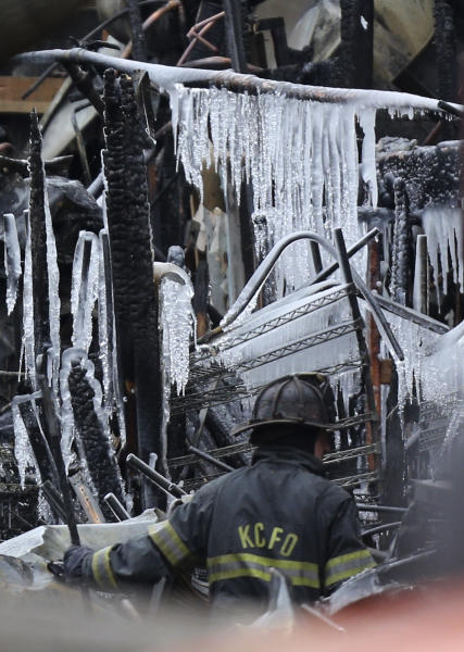A Kansas City Missouri firefighters moves debris as he sifts through the rubble of JJ's restaurant after an  explosion and fire tore through the establishment Tuesday evening near the Country Club Plaza Wednesday, Feb. 20, 2013, in Kansas City, Mo. The fire killed one person and injuring over a dozen. (AP Photo/Ed Zurga)