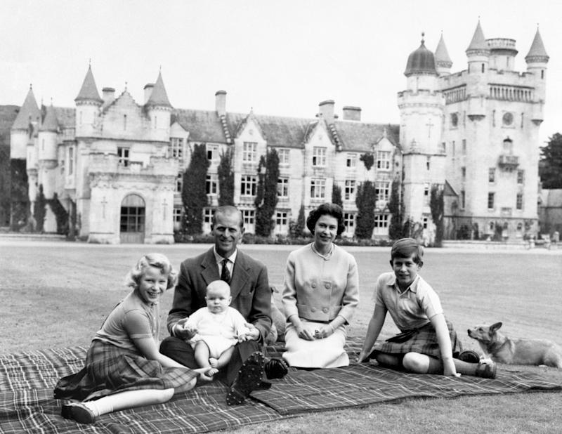 Making a happy group on the lawns at Balmoral, are the Queen, the Duke of Edinburgh and their three children Princess Anne, Prince Charles and baby Prince Andrew, on his father's knees. (Photo by PA Images via Getty Images)