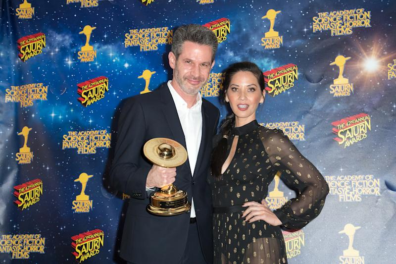 BURBANK, CA - JUNE 22: Simon Kinberg and Olivia Munn pose in the press room at the 42nd Annual Saturn Awards at The Castaway on June 22, 2016 in Burbank, California. (Photo by Michael Boardman/Getty Images)