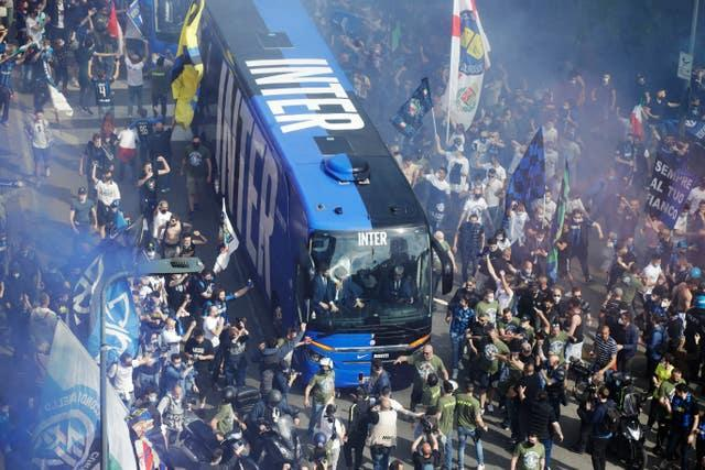 Inter Milan fans welcome the team bus ahead of the Serie A champions' game against Sampdoria