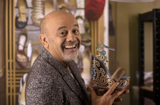 Thin edge of the wedge: French shoe designer Christian Louboutin with one of his intricate creations