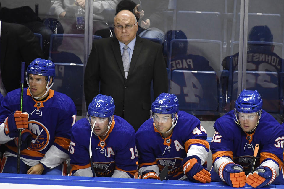 New York Islanders head coach Barry Trotz watches during an NHL preseason hockey game against the New Jersey Devils, Saturday, Oct. 2, 2021, in Bridgeport, Conn. (AP Photo/Jessica Hill)