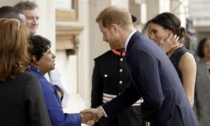 Prince Harry and his Meghan Markle are greeted by Doreen Lawrence, Stephen's mother, as they arrive to attend the service at St Martin-in-the-Fields church in London.
