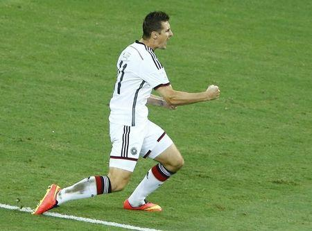 Germany's Miroslav Klose celebrates his goal during their 2014 World Cup Group G soccer match against Ghana at the Castelao arena in Fortaleza