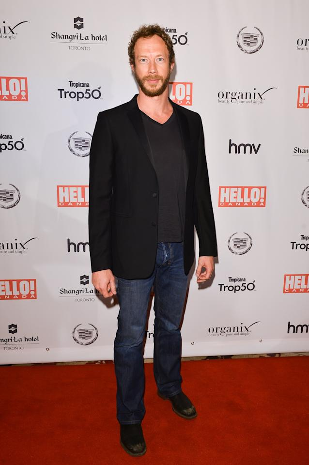 TORONTO, ON - MAY 09:  Actor Kris Holden Reid arrives at the Hello! Canada gala celebrating Canada's 50 most beautiful at Shangri-La Hotel on May 9, 2013 in Toronto, Canada.  (Photo by George Pimentel/Getty Images)