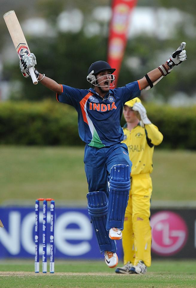 TOWNSVILLE, AUSTRALIA - AUGUST 26:  Smit Patel of India celebrates scoring the winning runs during the 2012 ICC U19 Cricket World Cup Final between Australia and India at Tony Ireland Stadium on August 26, 2012 in Townsville, Australia.  (Photo by Matt Roberts/Getty Images)