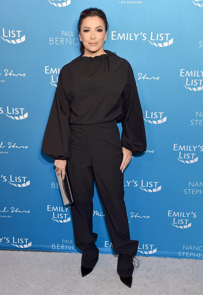 <p>Wearing a black on black pant and top. </p>