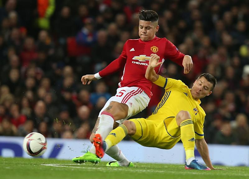 MANCHESTER, ENGLAND - MARCH 16: Marcos Rojo of Manchester United in action with Dmitri Poloz of FK Rostov during the UEFA Europa League Round of 16 second leg match between Manchester United and FK Rostov at Old Trafford on March 16, 2017 in Manchester, United Kingdom. (Photo by Matthew Peters/Man Utd via Getty Images) - Credit: Matthew Peters/Man Utd via Getty Images
