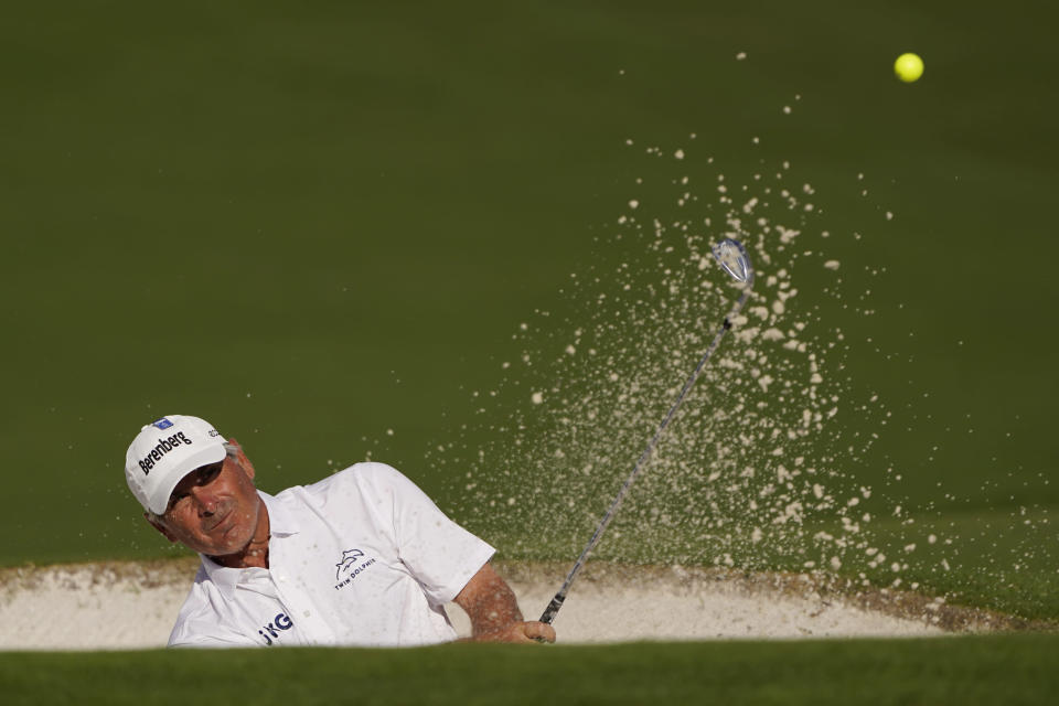 Fred Couples watches his bunker shot on the ninth hole during the first round of the Masters golf tournament on Friday, Nov. 13, 2020, in Augusta, Ga. (AP Photo/Chris Carlson)